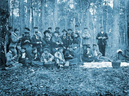 Students from Florida Agricultural College in Lake City relax at a picnic on the Suwannee River in 1895. The college was established through the Morrill Act and later merged with other area institutions to form the University of Florida in 1905.