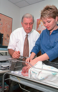 Dr. Joseph Kemker and Dr. Emily McClain, audiologists in the department of speech, language, and hearing sciences, test the hearing of a Gainesville infant in this circa 2000 photo. This year marks the 15th anniversary of Florida's universal newborn hearing screening program. Early detection of hearing problems allows clinicians to provide interventions during the first few months of life, an important period for language and speech development.